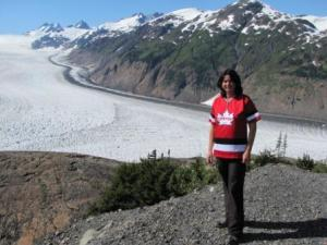As a tour guide posing in front of the Salmon Glacier, Northern BC